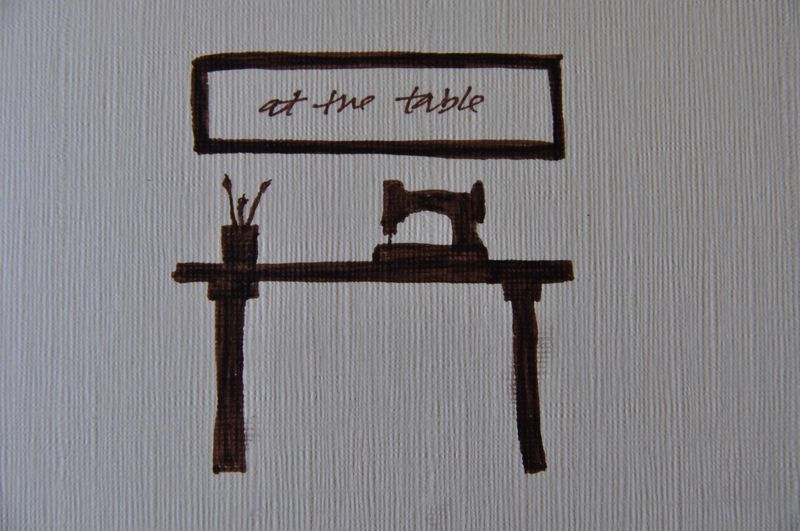 At the table small logo